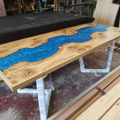 Framed oak River table having a final check over before delivery