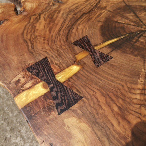 Walnut cookie table with wenge bowties and gold resin inlay