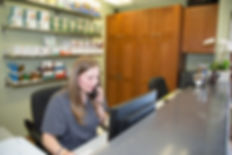 Picture of front desk with receptionist