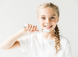 adorable happy child brushing teeth and smiling at camera isolated on white.jpg