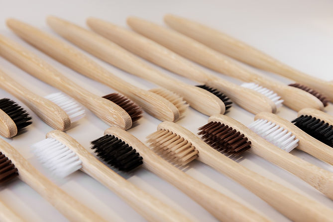 Group of eco bamboo toothbrushes, on white background. Different color. Top view, pattern,
