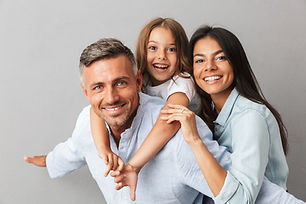 Portrait of a happy family father, mother, little daughter having fun together, father hol