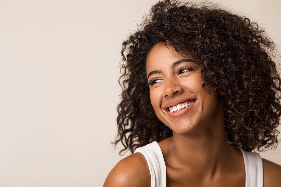 Beauty portrait of happy black woman on light background.jpg