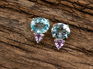 Blue-Topaz-oval-with-Brazillian-Amethyst