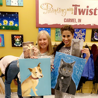 Lisa and Kat posing with their works of art after our Painting with a Twist staff party! (2018)