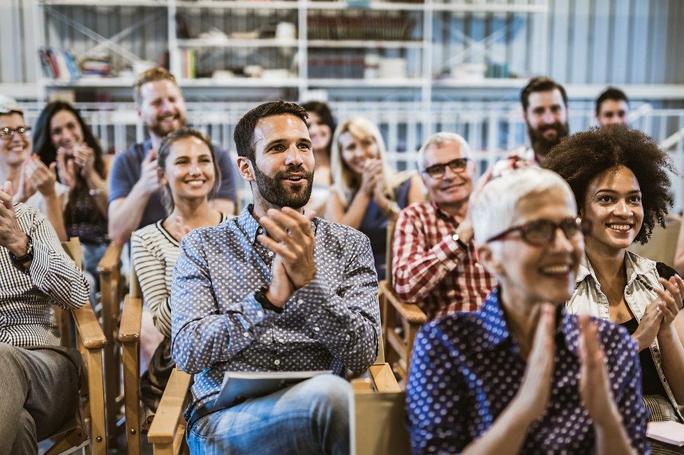 People applauding an inspiring speaker
