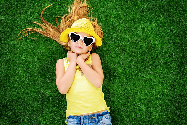 Joyful little girl in colorful clothes a