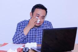 gay wiping tears
