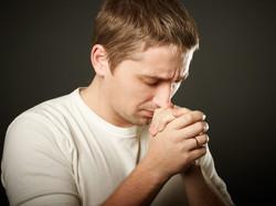 Man-Praying-Hands-on-Chest.jpg