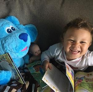 Micah reading to dolls.jpg