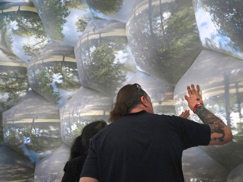 visitors experience the miraculous nature of vision anewPneuhaus Compound Camera Inflatable Art Architecture Experimental Event Space Experiental Art Installation Optical Interactive Science based nature inspired art artwork immersive dome geodesic futuristic design camera obscura pinhole camera live projection white dome multiplied view kaleidoscope psychedelic vision inspired light art installation textile art touch to focus  festival art public art Photography Touchable Art Exhibition