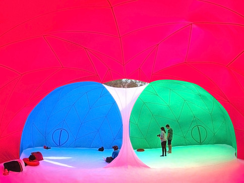 Pneuhaus RGBubble Inflatable Art Architecture Experimental Experience Design Rainbow Light Art Inspired by Nature Physics of Light Tent Event Space Immersive Interactive Installation Art All Ages Family Public Art Festival Silent Disco Color Art Minimal TriColor Red Blue Green Photographer Textile Art Building Fabric Structure