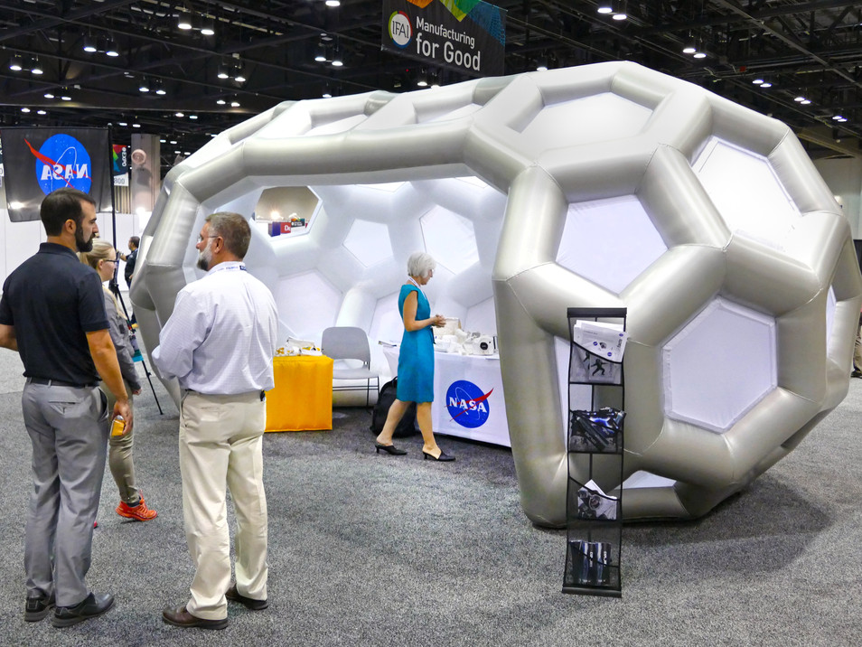 Pneuhaus NASA Inflatable Kiosk Futuristic Design Geodesic Structure Inflatable Architecture Art Installation Capsule Kiosk Experimental Event Design Experiential Brand Design NASA Conference Display Sci Fi Art Hexagon Hexagonal Building Silver White
