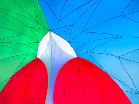 Pneuhaus RGBubble Inflatable Art Architecture Experimental Experience Design Rainbow Light Art Inspired by Nature Physics of Light Tent Event Space Immersive Interactive Installation Art All Ages Family Public Art Festival Silent Disco Color Art Minimal TriColor Red Blue Green Textile Art BuildingTextile Art Building Fabric Structure