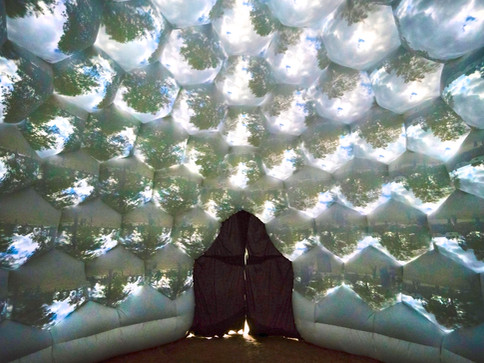 Pneuhaus Compound Camera Inflatable Art Architecture Experimental Event Space Experiental Art Installation Optical Interactive Science based nature inspired art artwork immersive dome geodesic futuristic design camera obscura pinhole camera live projection white dome multiplied view kaleidoscope psychedelic vision inspired light art installation festival art public art textile art wall of eyes