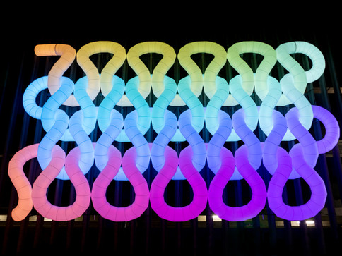 Pneuhaus Pnit PVD Fest Inflatable Art Public Festival Art Light Art Providence Arts Festival Department of Culture and Tourism Giant Knit Huge Knitting Sculpture LEDs Wall Relief Art Installation City Art Roadside Colorful Contemporary Hanging Sculpture Commission Artist Collective Night Rainbow Textile Art Structural Fabric Sculpture Light Festival