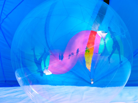 Pneuhaus Gakko Dome Inflatable Architecture Color Art Experimental Experience Design Rainbow Light Art Inspired by Nature Physics of Light Tent Event Space Dome Immersive Interactive Installation Art Conference Room Center Public Art Festival Cyan Yellow Magenta Commissions Rentals Brand Experience Summer Camp Art Video Presentation Dialogue Discussion Screening Light Art Color Mixing Textile Art Fabric Building Structure
