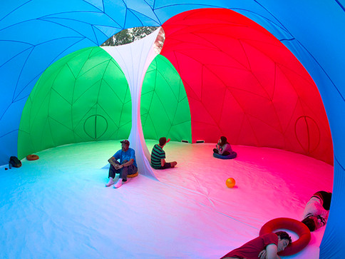 Pneuhaus RGBubble Inflatable Art Architecture Experimental Experience Design Rainbow Light Art Inspired by Nature Physics of Light Tent Event Space Immersive Interactive Installation Art All Ages Family Public Art Festival Silent Disco Color Art Minimal TriColor Red Blue Green Textile Art Building Fabric Structure