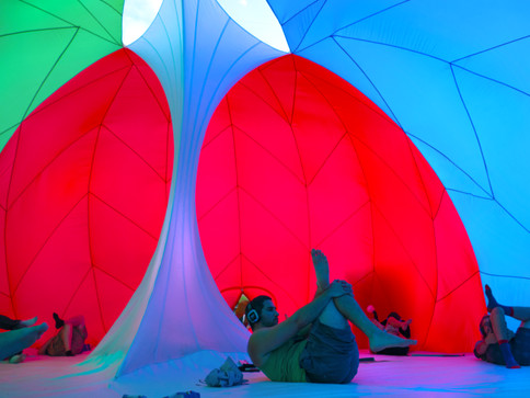 Pneuhaus RGBubble Inflatable Art Architecture Experimental Experience Design Rainbow Light Art Inspired by Nature Physics of Light Tent Event Space Immersive Interactive Installation Art All Ages Family Public Art Festival Silent Disco Color Art Minimal TriColor Red Blue Green Yoga Event Party Group ExperienceTextile Art Building Fabric Structure