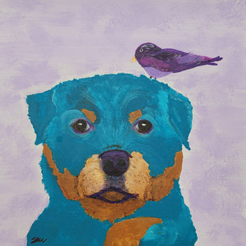 Young puppy and bird