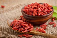 red-dried-goji-berries-in-wooden-spoon.j