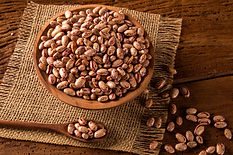 beans-into-bowl-wooden-table.jpg