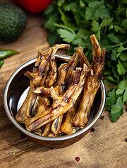 dried-chicken-legs-dog-vessel-among-gree
