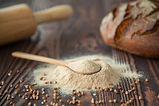 close-up-spoon-with-buckwheat-flour-wood