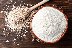 oat-flakes-flour-dark-wood.jpg