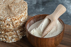 stack-rice-cakes-bowl-flour-wooden-board
