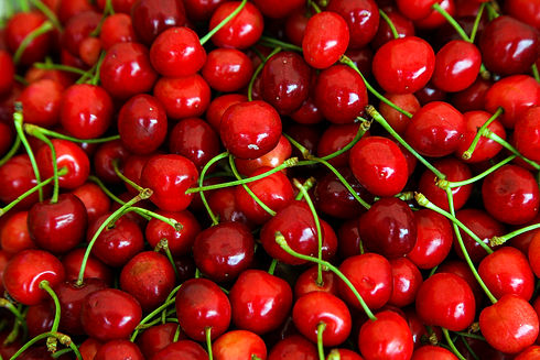 red-cherries-with-green-stems-top-view.j