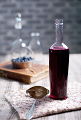 old-wine-bottle-with-homemade-berry-vine