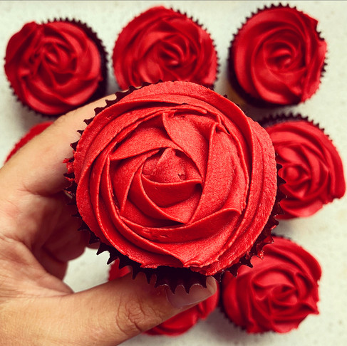 Chocolate cupcakes with buttercream rose icing
