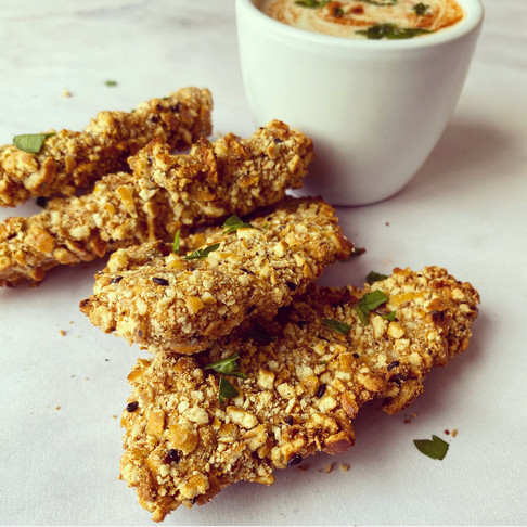Pretzel crumbed chicken tenders with a spicy honey, lime and yogurt dip