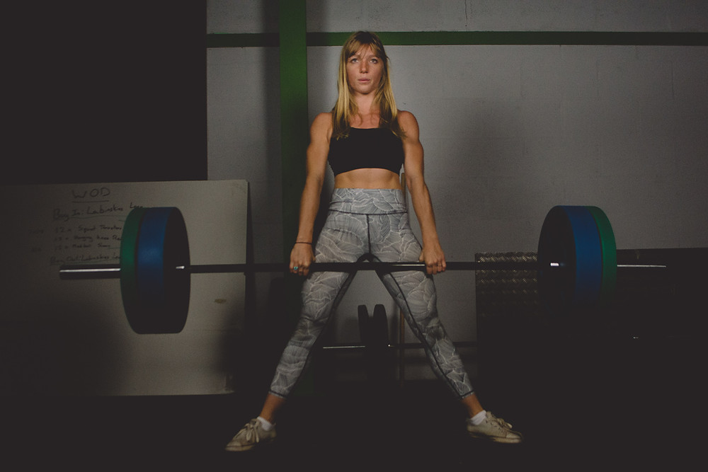 small business marketing personal trainer performing a deadlift