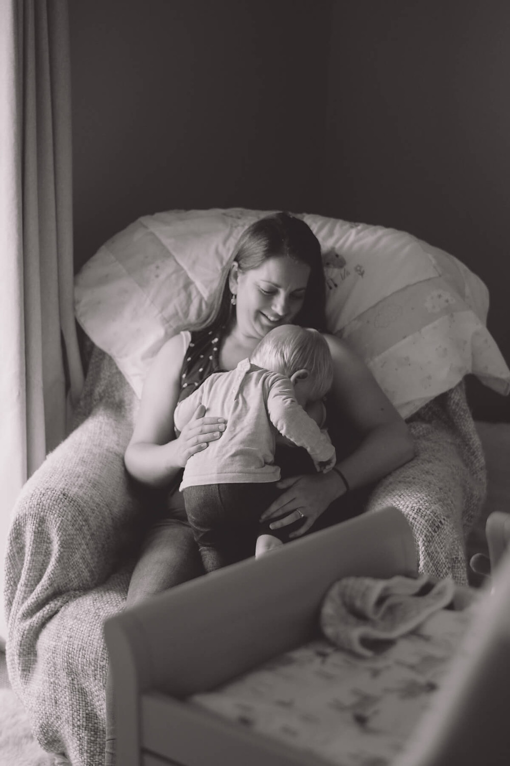 breastfeeding mother with one year old biological feeding