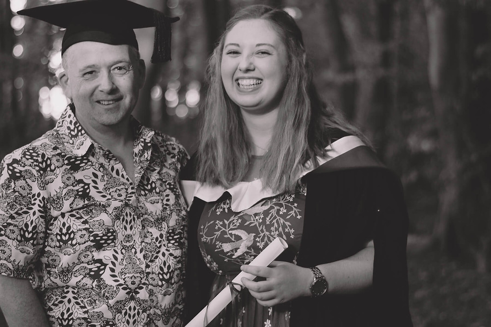 father and daughter graduation portrait