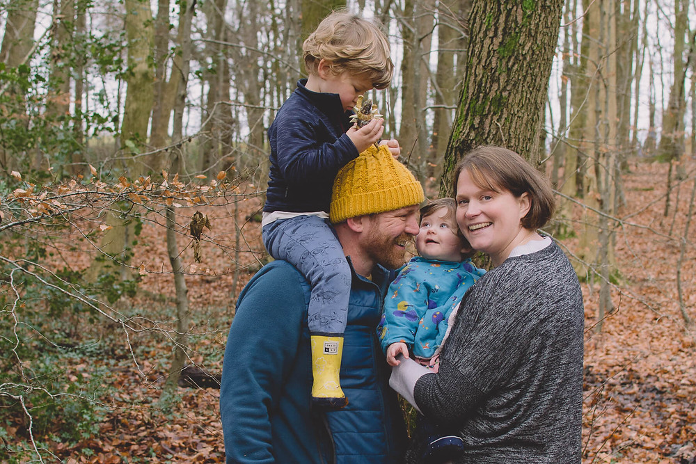 Family Photographer South Wales family play in forest