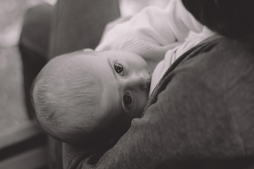 breastfeeding baby big eyes black and white