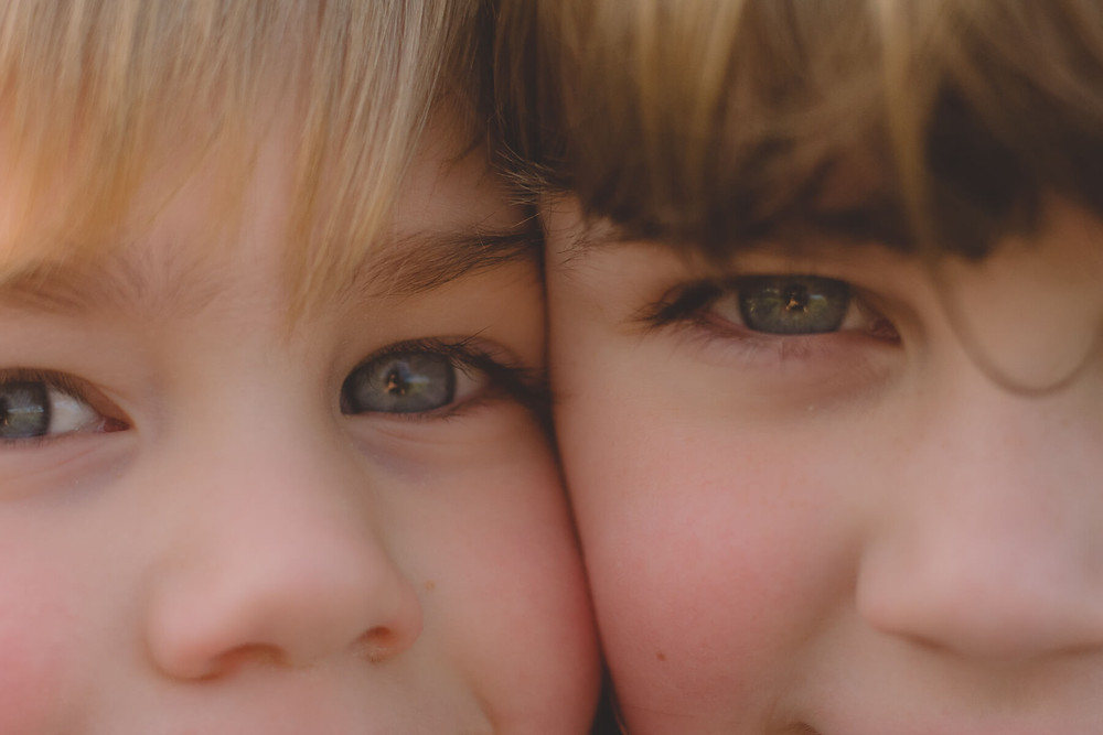 brother and sister close up of eyes together