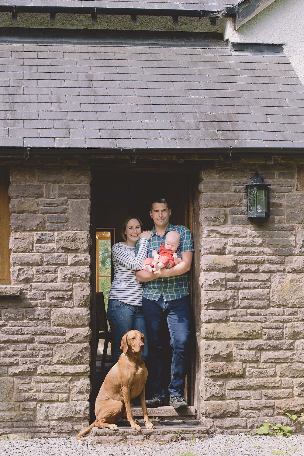 Abergavenny Newborn Photographer family with baby front door