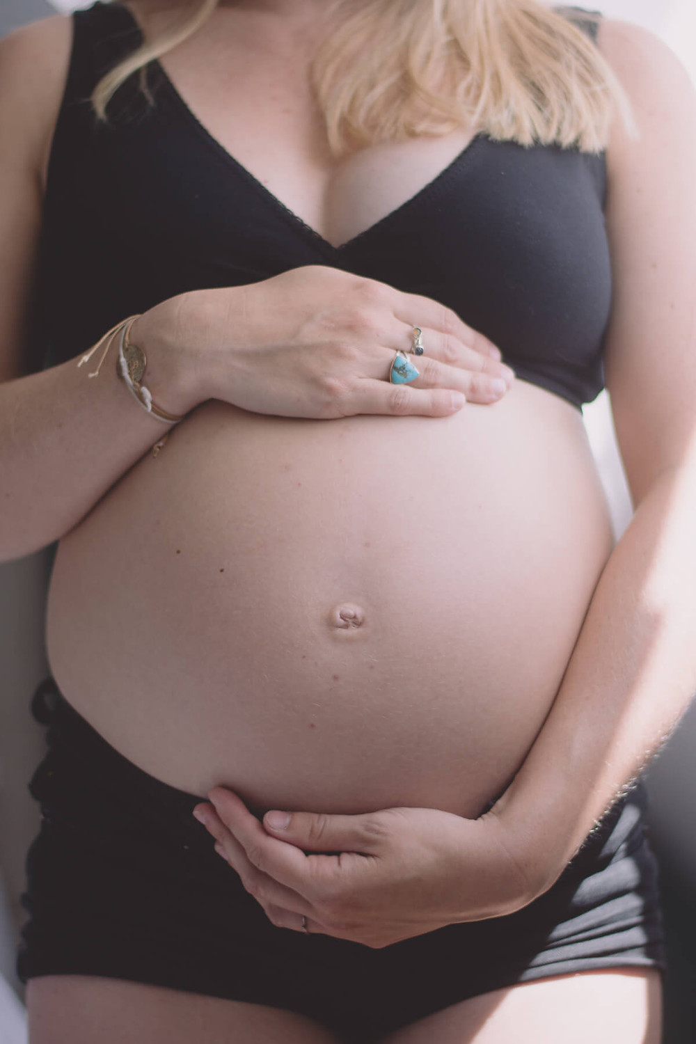 pregnant belly close up hands cradle bump rings south wales