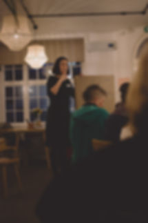 commercial photography bristol woman gives talk in front of board at networking event