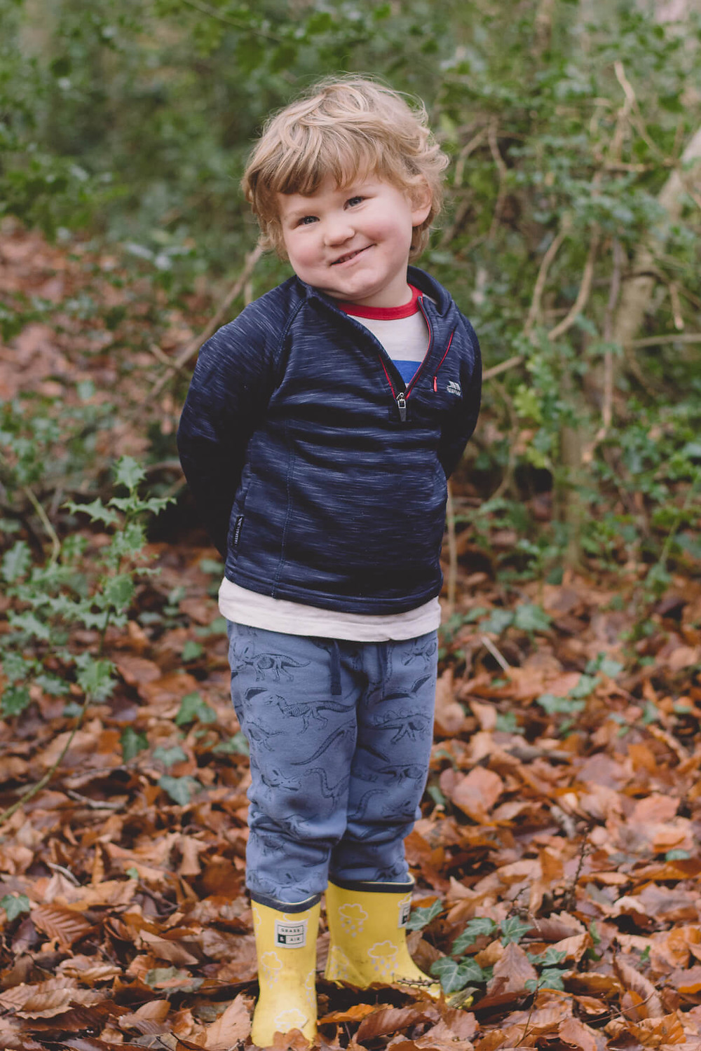 family photoshoot south wales boy smiling in forest autumn