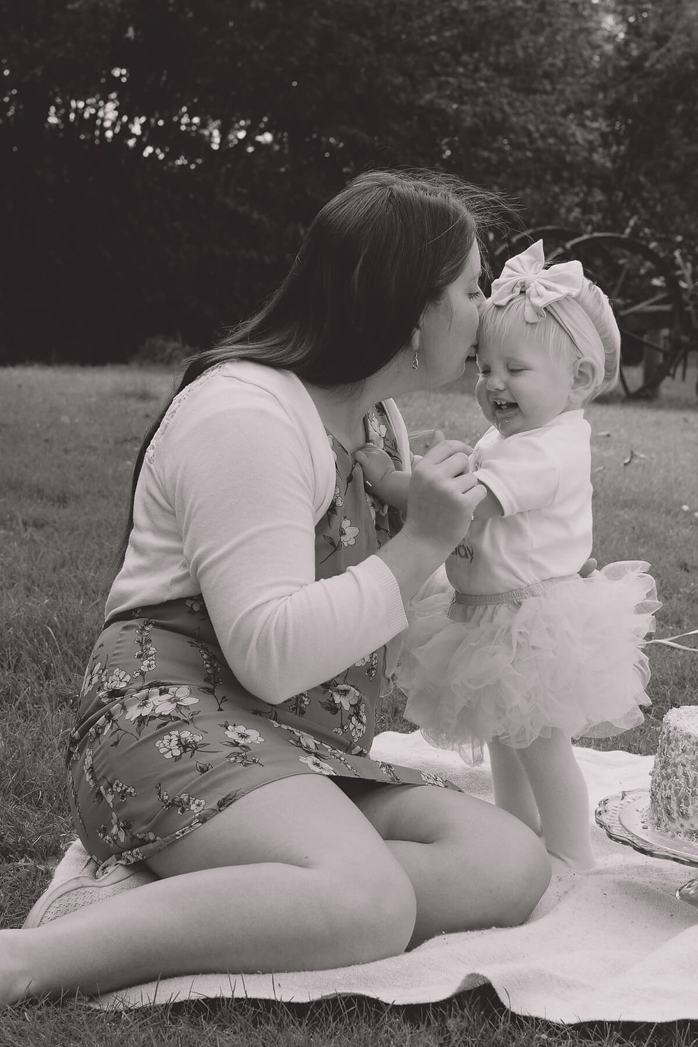 mum kisses one year old in tutu on forehead