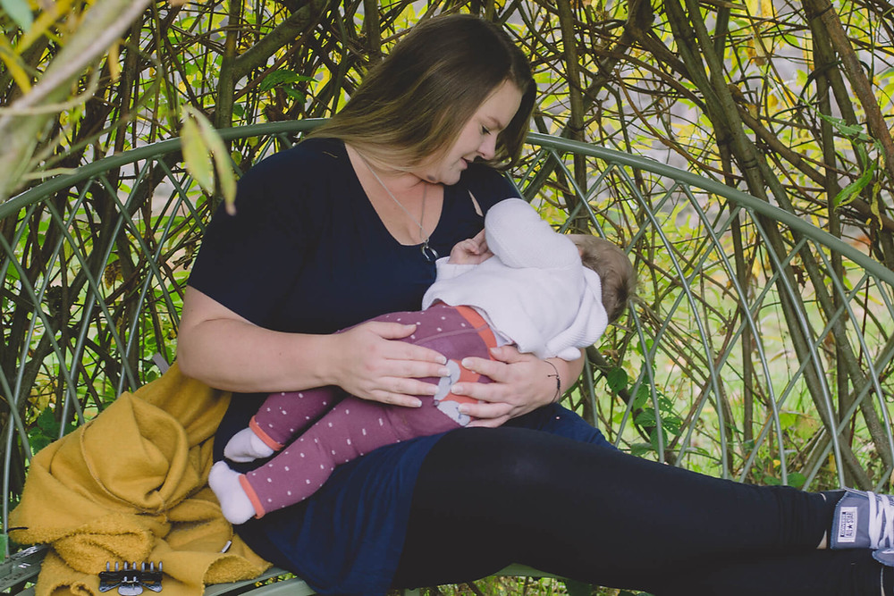 mother breastfeeding daughter surrounded by willow