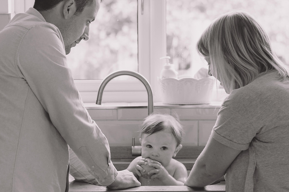 lifestyle photographer south wales toddler kitchen sink