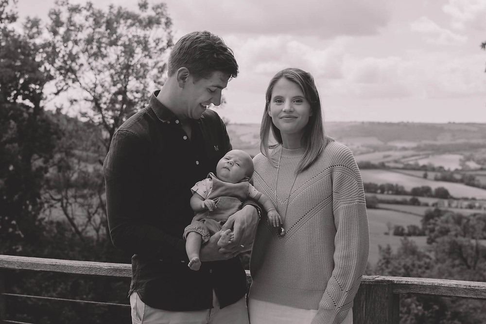 black and white young family welsh hills in background