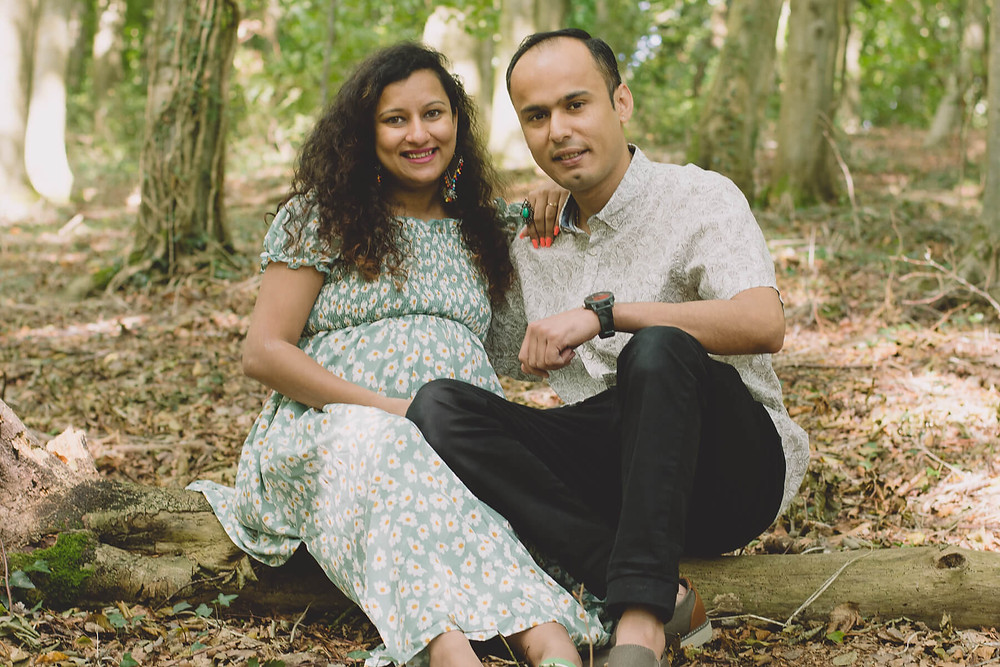 smiling asian couple pregnant