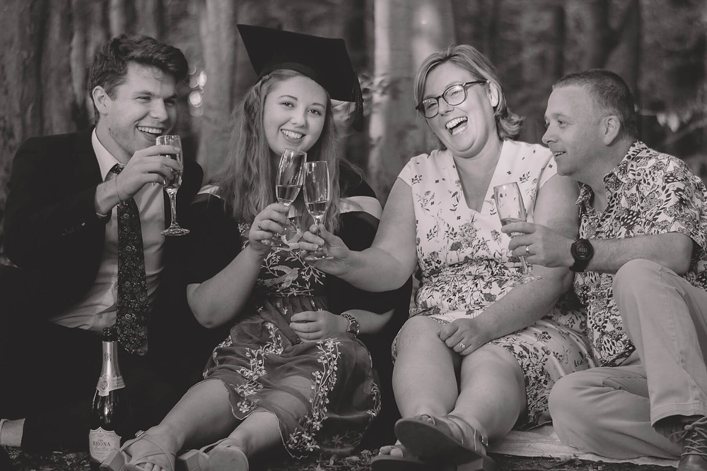 family portrait graduation cheers champagne
